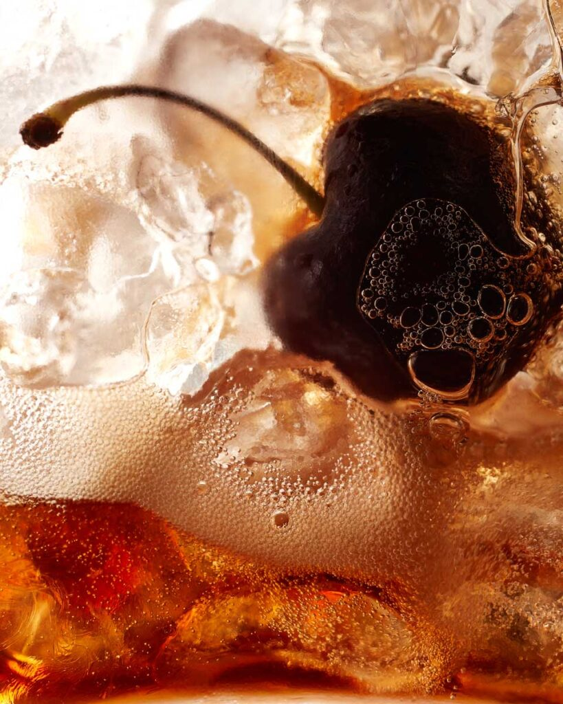 Fresh cherry in a brandy and coke photographed in a drink photography studio