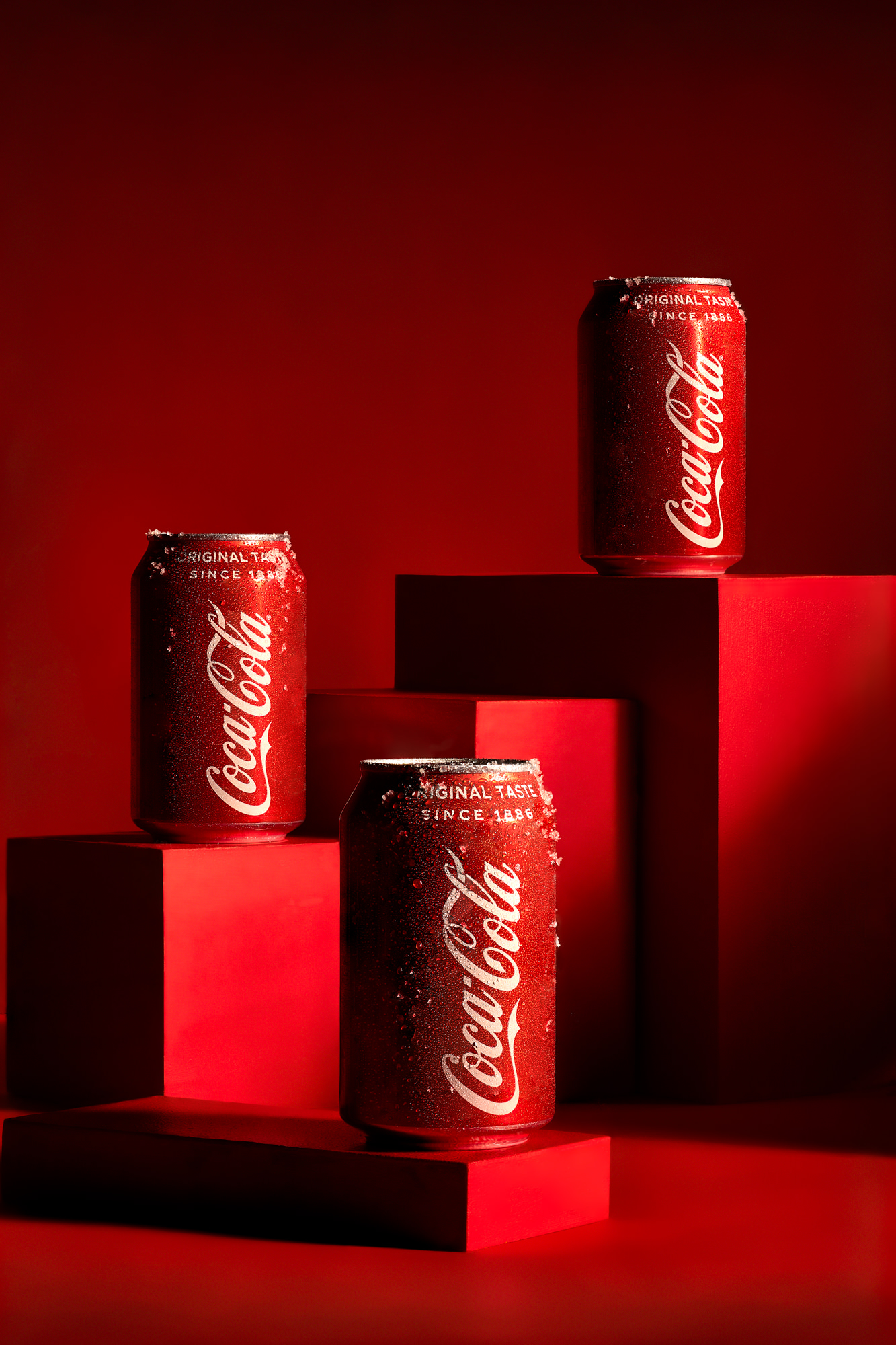 Coca Cola cans by food and drink photographer Scott Choucino