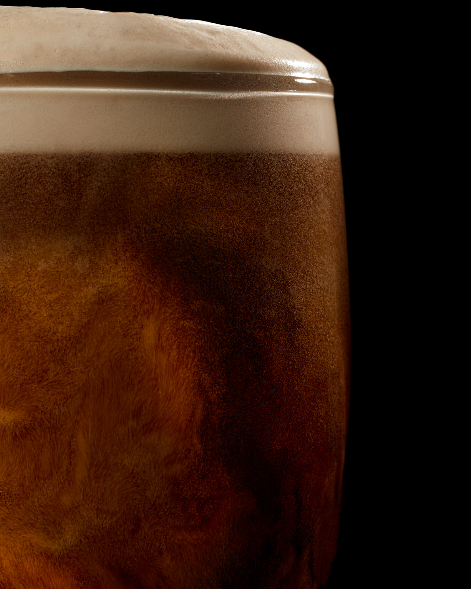 Pint of Guinness settling in a drink photography studio