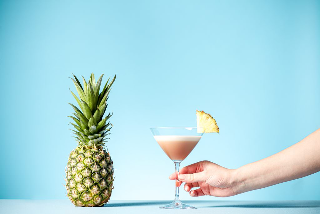 Hand picking up a french Martini