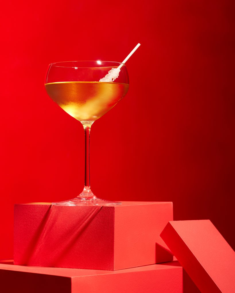Classic martini cocktail photograph on pure red