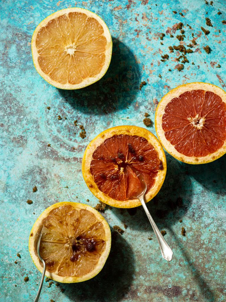 Grapefruits with brown sugar on a bright blackvelvet styling background