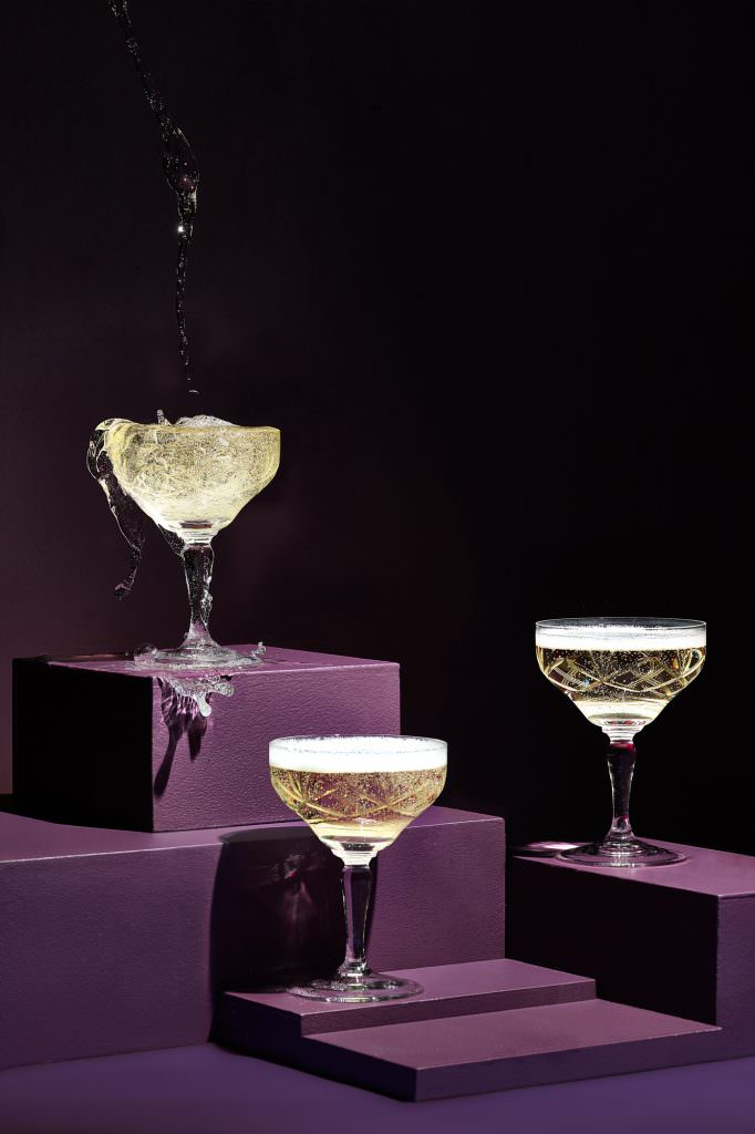Vintage champagne image with coup over flowing with drink