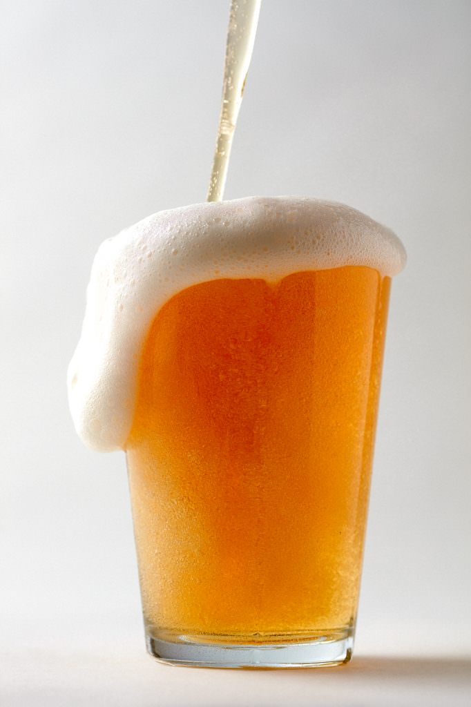 Pint of beer being poured in a studio