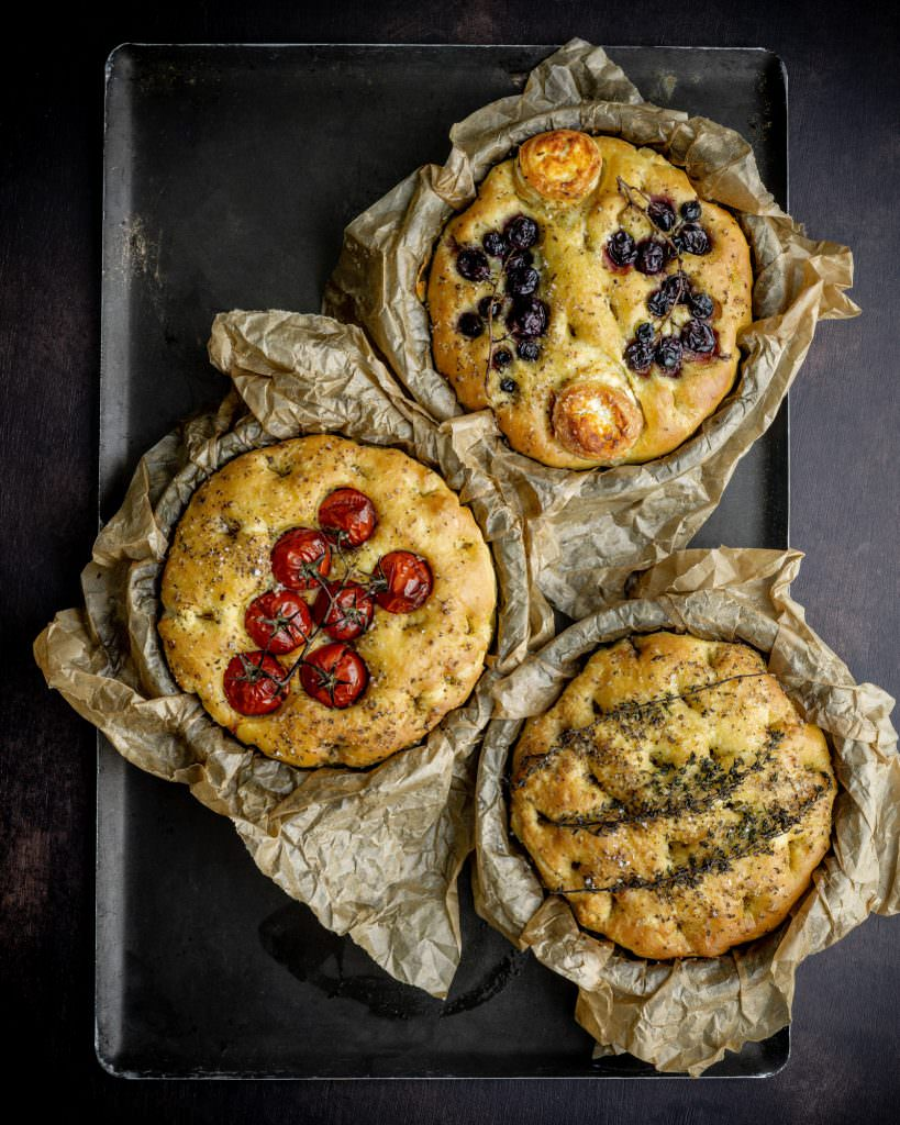 3 focaccia with tomatoes, grapes, and herbs
