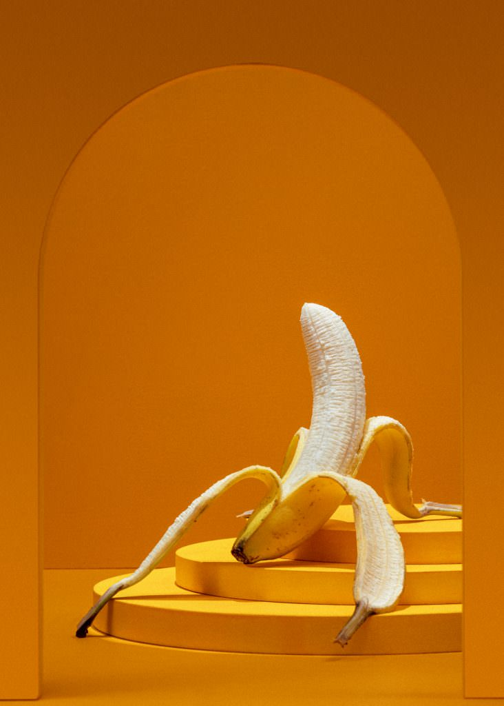 Banana undressing itself in a fruit photography by scott choucino