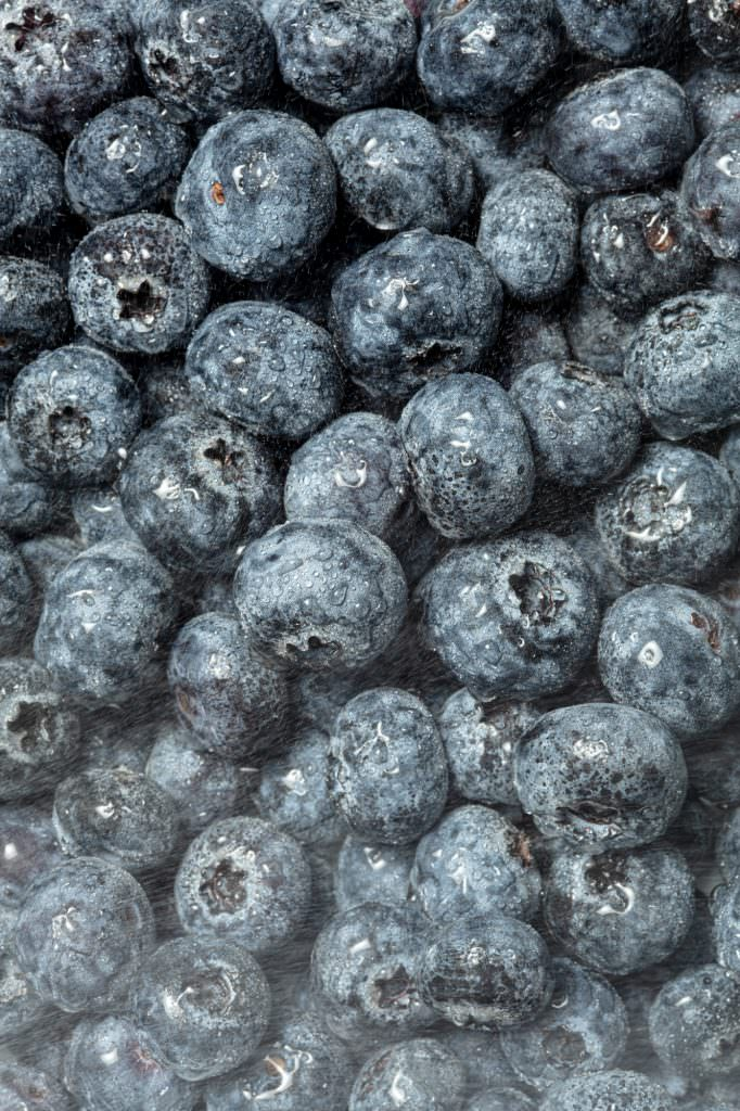 Graphic image of blueberries being washed