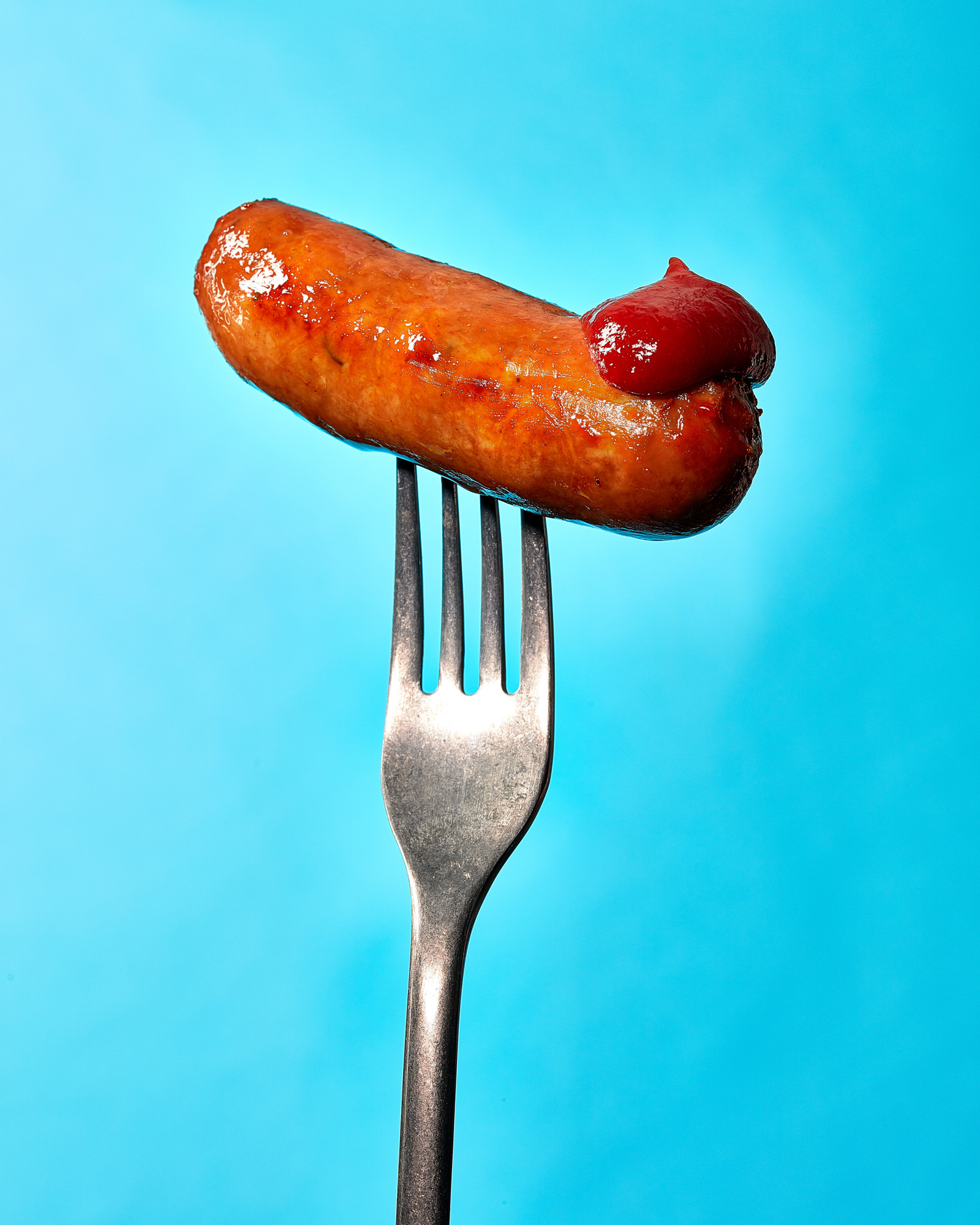 Classic british sausage photographed with tomato ketchup