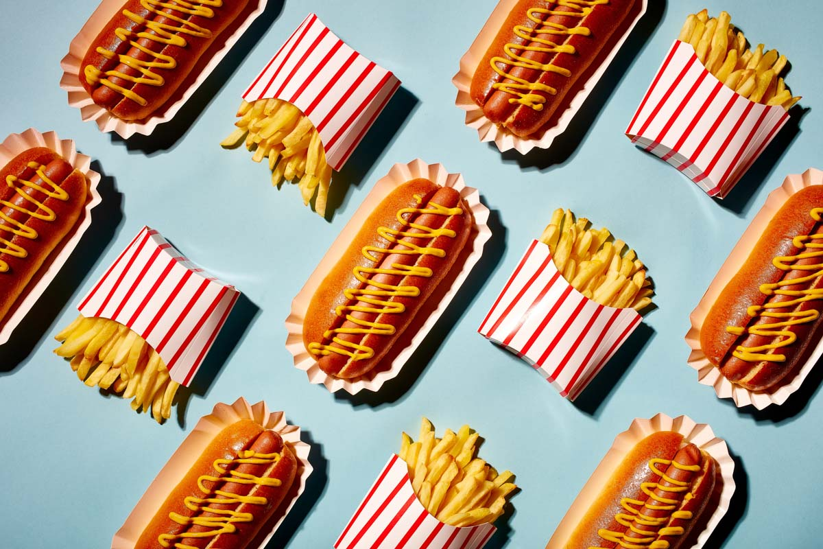 Pop art food photography of hotdogs and french fries