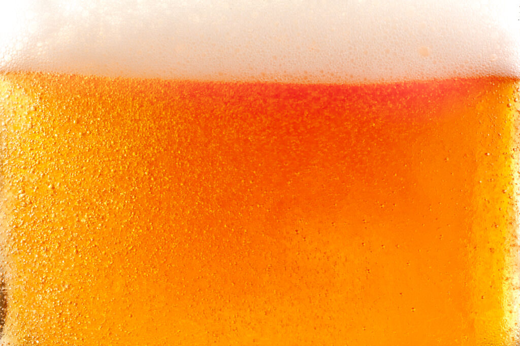 Close up photograph of a pint of larger by drink photographer scott choucino
